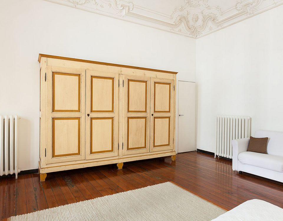 view of antique wardrobe in a hotel room